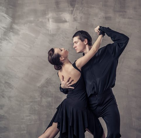 Young couple dancing the Argentine tango in the studio