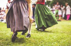 Nykil, Sweden - June 21, 2013: Swedish midsummer, midsommar, celebration in Nykil, ?sterg?tland. Typically clothed swedish folk dancers dancing around a midsummer pole.